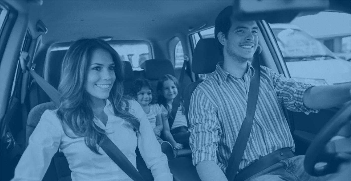 family in car smiling