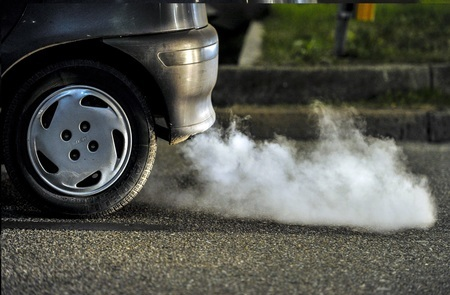Polluting car fumes released from exhaust pipe