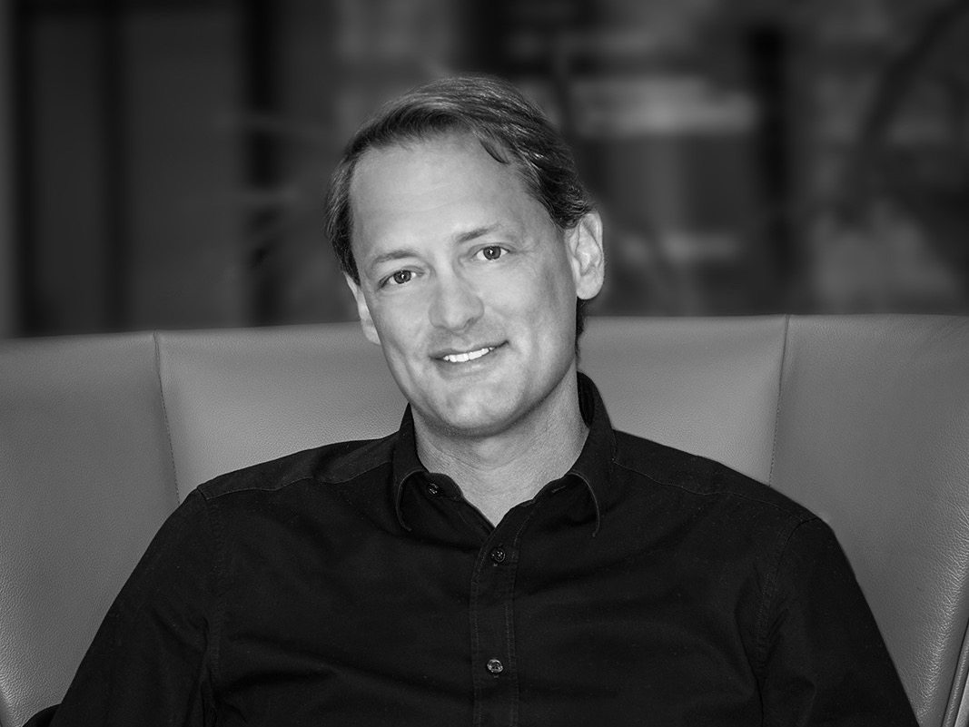The Floow's CEO Aldo Monteforte in black and white smiling at the camera
