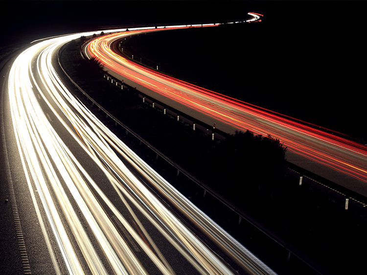 Blurred vehicles lights on roads in the dark
