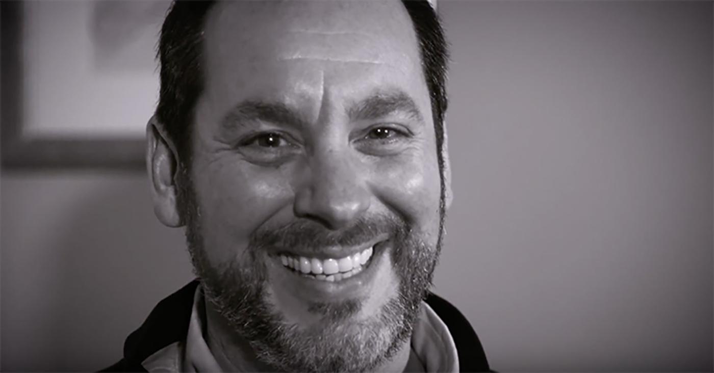 close up of John Kramer smiling